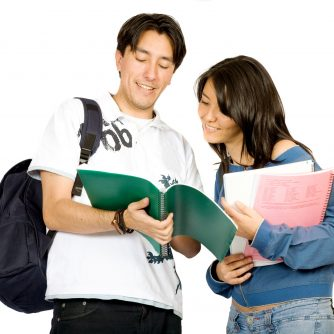 casual students over a white background - standing and smiling